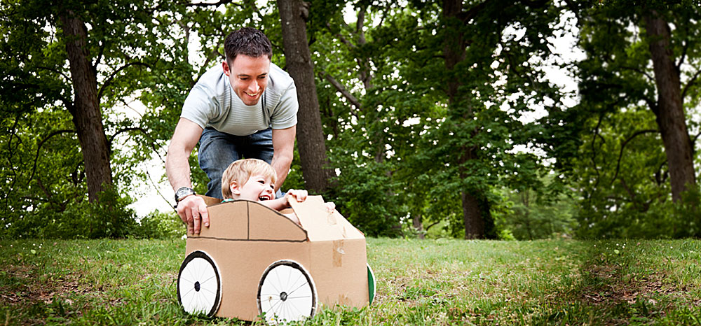 HM Risk: Auto. Child in cardboard car photo.